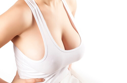 women with large breasts in a white shirt